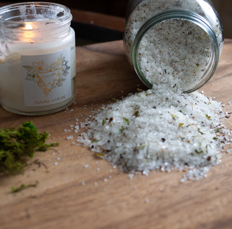 botanical bathing salts with candle on wooden tray