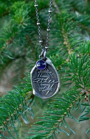 ether silver talisman necklace with evergreen branches