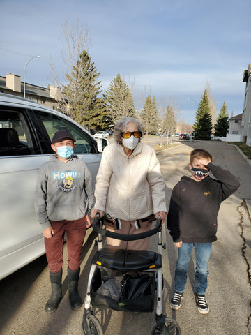 granny and two great grandsons in masks