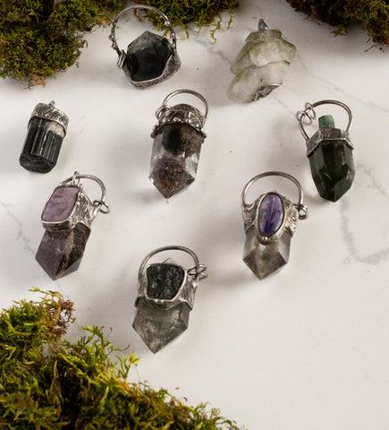 collection of green nature inspired crystal talisman pendants