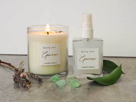 spring equinox candle and ritual spray with green crystal