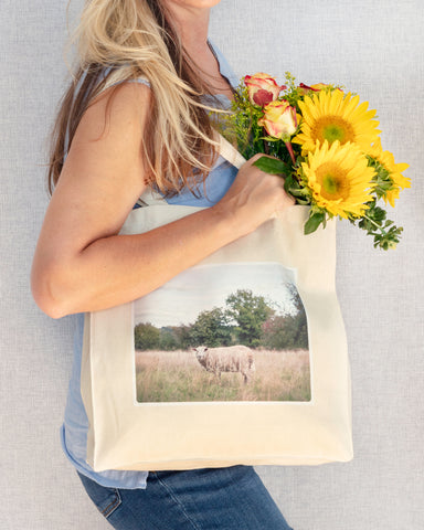 woman with yellow flowers holding cotton canvas tote with sheep