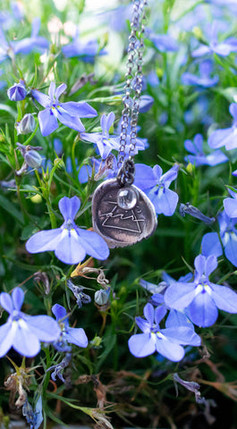silver air sign talisman necklace with purple flowers