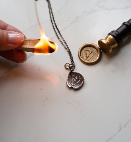 fire sign silver medallion necklace with wax stamp and seal