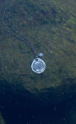 silver water sign necklace underwater