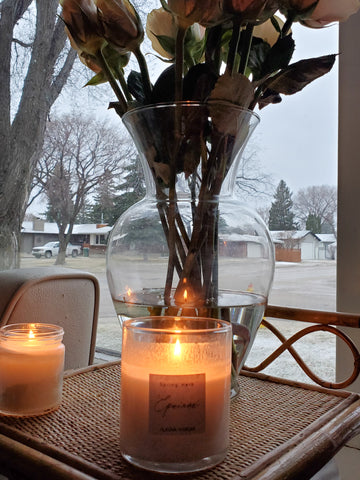 spring equinox ritual candle on wicker table with fresh roses