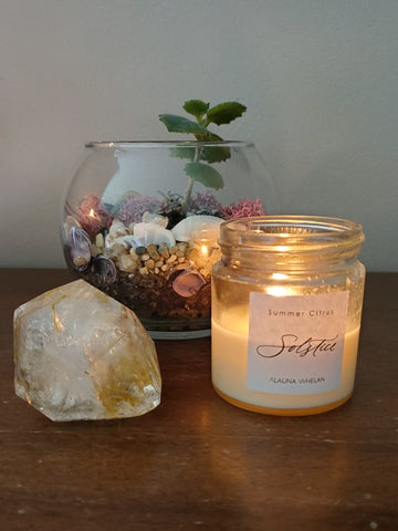 soy summer solstice candle with large crystal and succulent