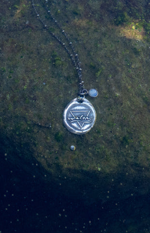 water sign medallion necklace with moonstone crystal underwater