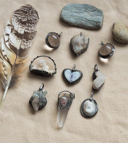 various clear and white raw crystal talisman pendants