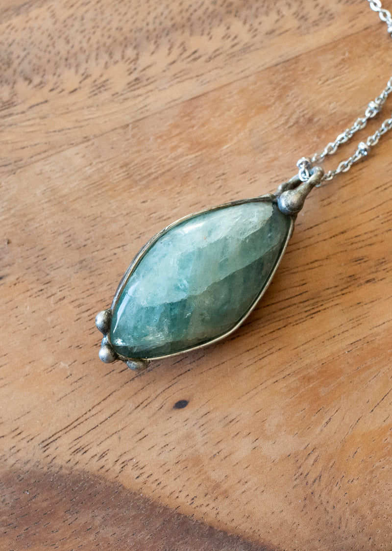 raw aquamarine blue crystal gemstone talisman pendant