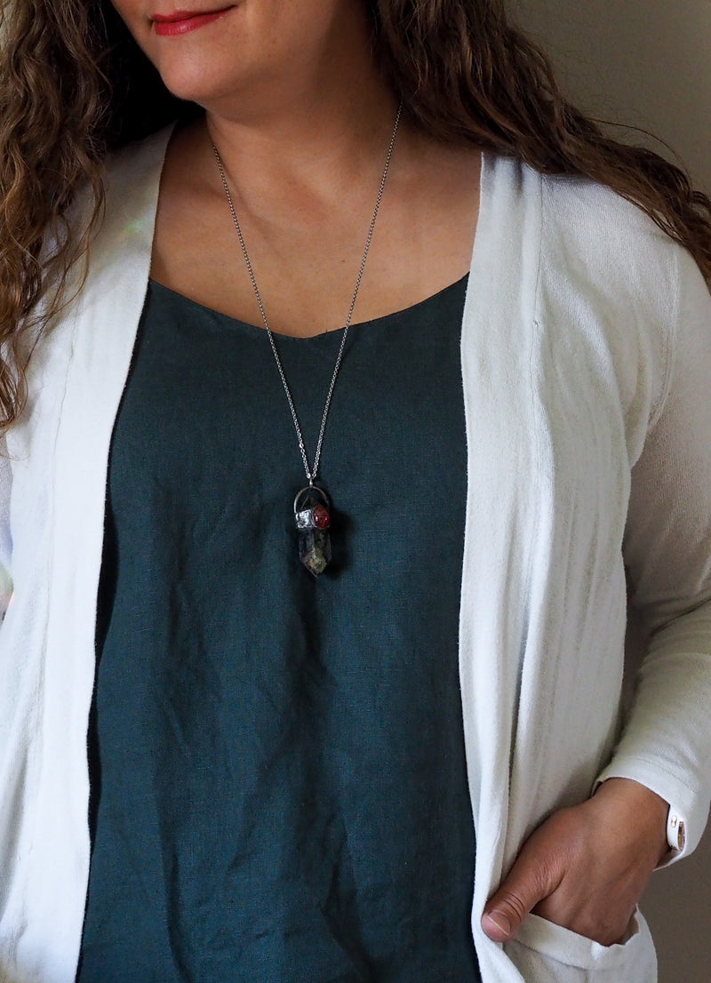 lodolite and carved carnelian scarab crystal talisman necklace on woman in blue top