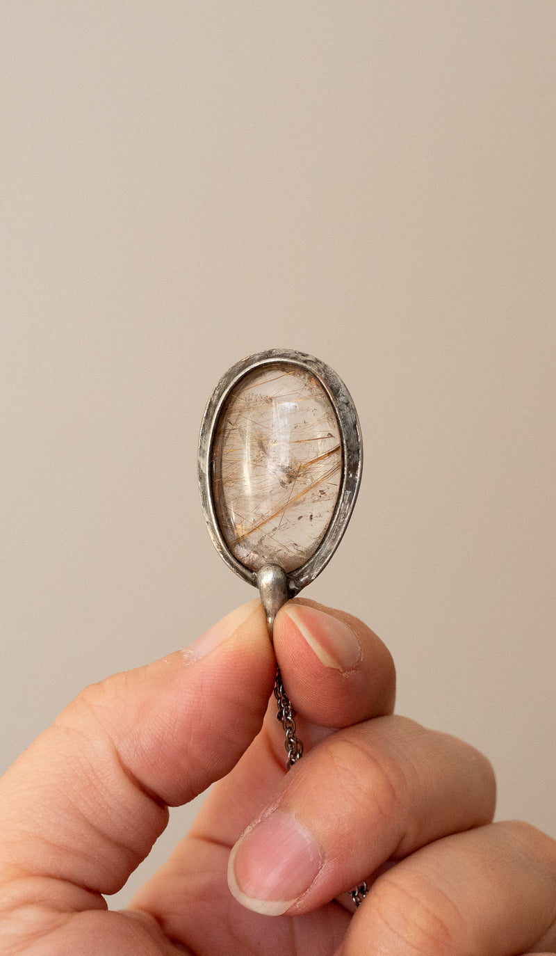 rutilated quartz crystal talisman pendant