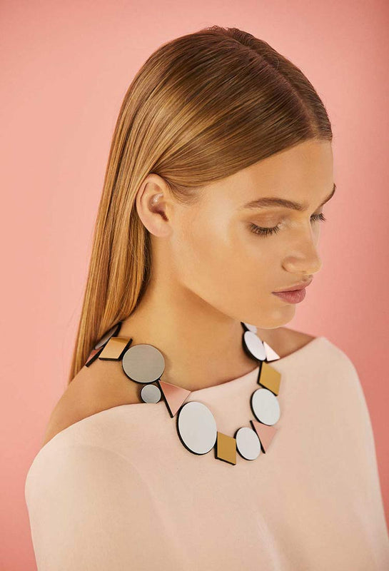 Kaia necklace geometric by Iskin Sisters. Necklace of geometric shape made of suede and acrylic with magnetic clasp. It's very lightweight and comfortable to wear!