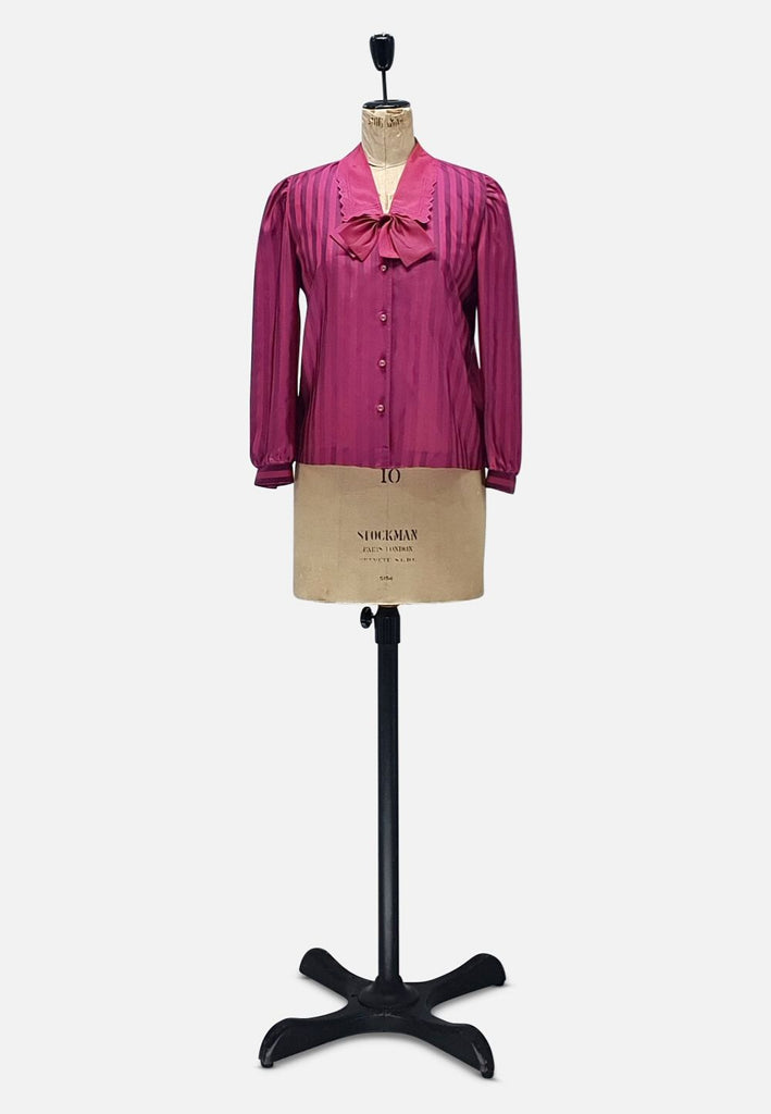 Stripe it up in fuchsia blouse
