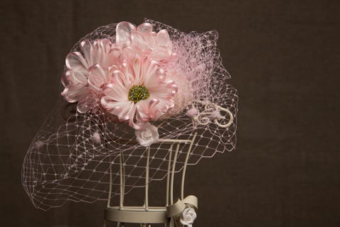 Gerbera daisy button with vintage style veiling