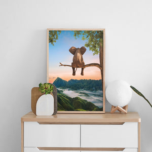 Magical and visual wall art designs for home decoration. High Quality posters full of creativity and imagination with a little elephant sitting on a tree watching sunset.