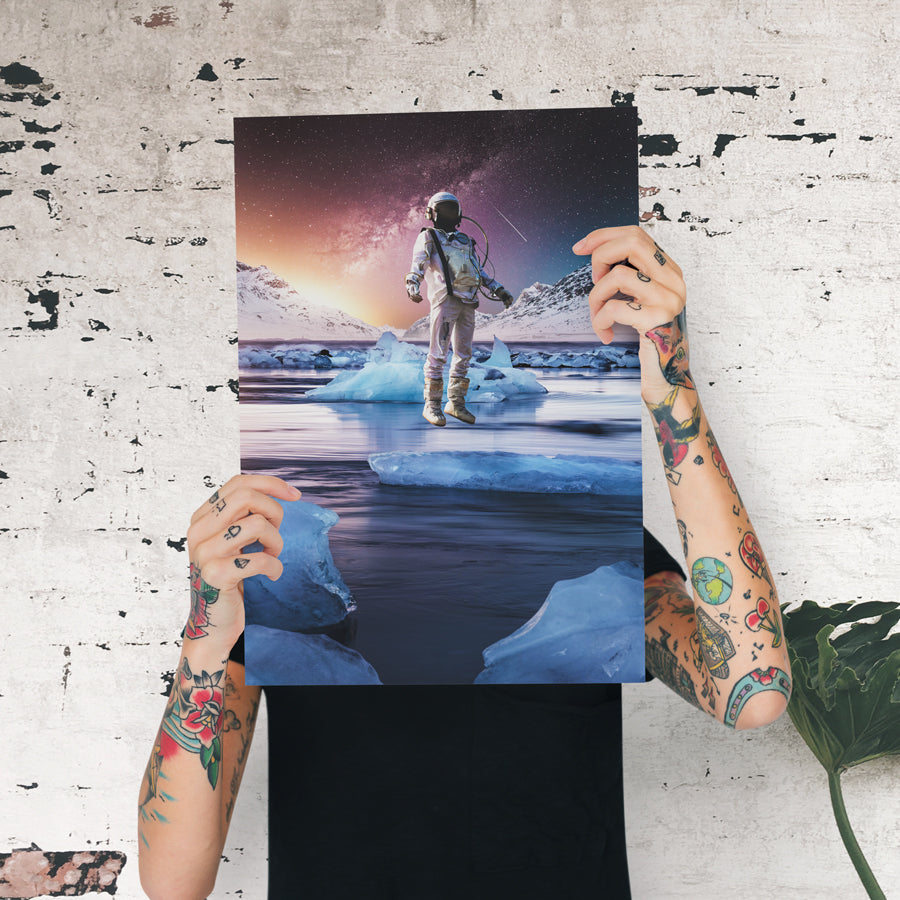 Magical and visual wall art designs for home decoration. High Quality posters full of creativity and imagination. Astronaut levitating over an iced lake under a sky full of stars where you can see the planets and milky way.