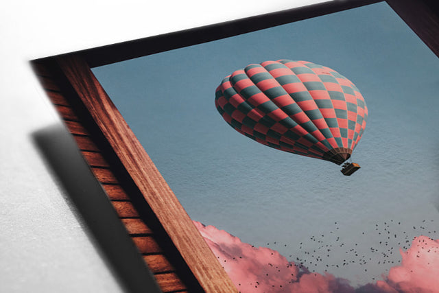 Magical and visual wall art designs for home decoration. High Quality posters full of creativity and imagination with wildlife, landscapes, nature and visual compositions. Dreamy view from the window of a hot air ballon above the pink clouds.