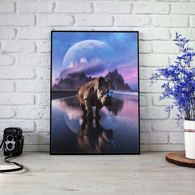Magical and visual wall art designs for home decoration. High Quality posters full of creativity and imagination with wildlife, landscapes, nature and visual compositions. Magical Rhino with a galaxy horn under a sky with planets.