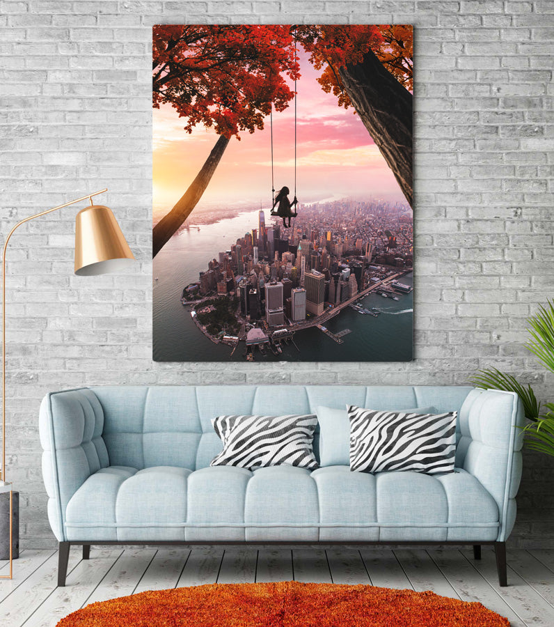 Magical and visual wall art designs for home decoration. High Quality posters full of creativity and imagination. Girl on a swing over Manhattan in New York City.