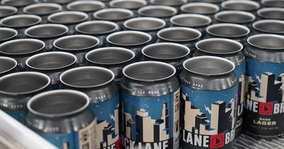 Base Lager cans out the door