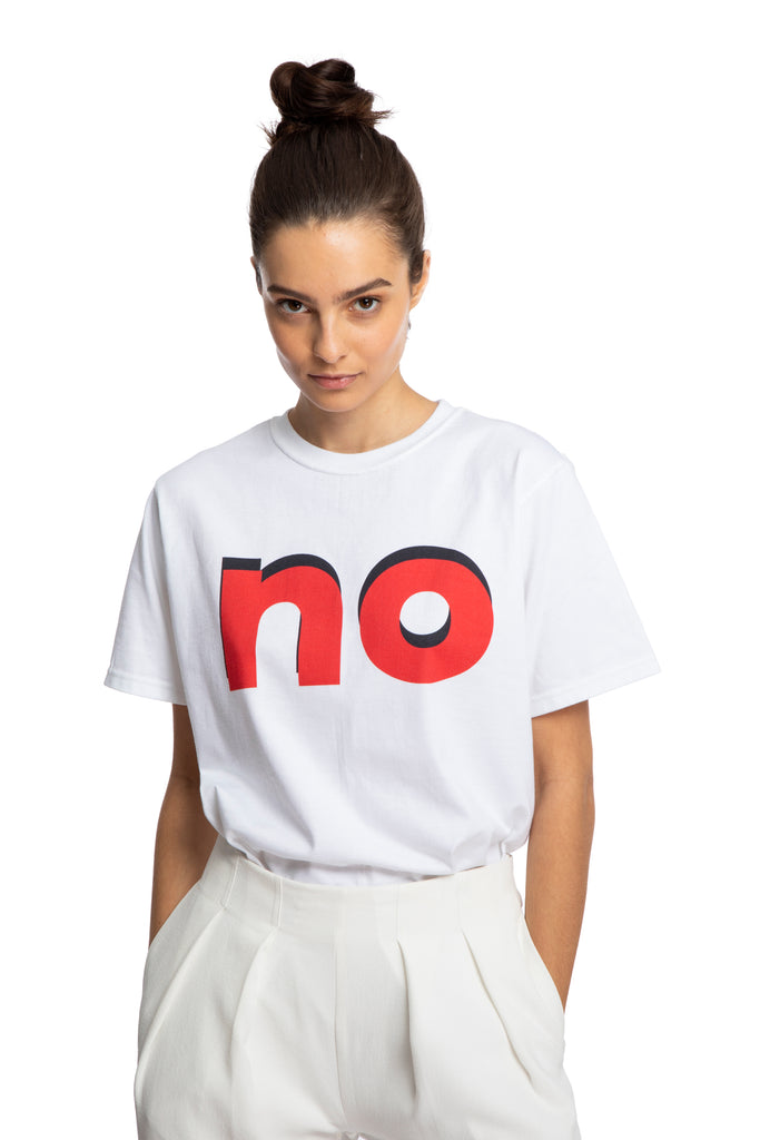 "NINObrand NO Organic Tee White short sleeve tee with crew neck ""NO"" written large on the front in red with black drop shadow Grommet detail under the arm on side seam 100% Organic cotton Machine wash cold. Do not bleach. Tumble dry low heat."