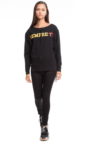 NINObrand black ponte scoop neck pullover top with red and yellow letters