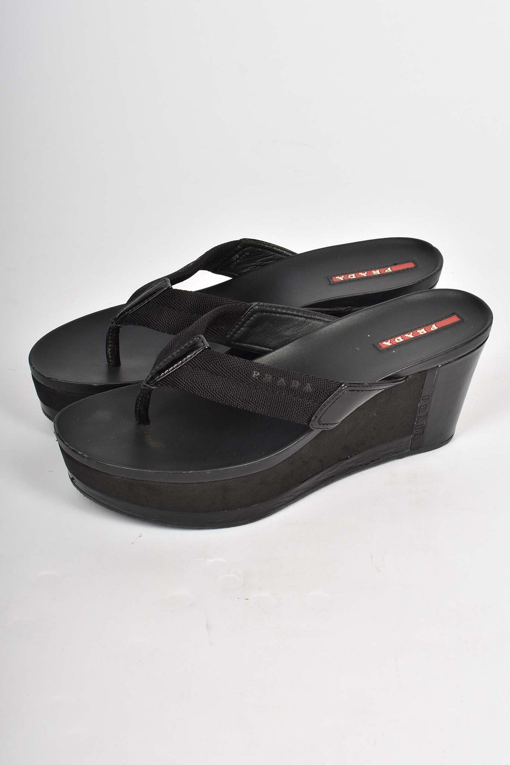 Prada black flip flop wedges