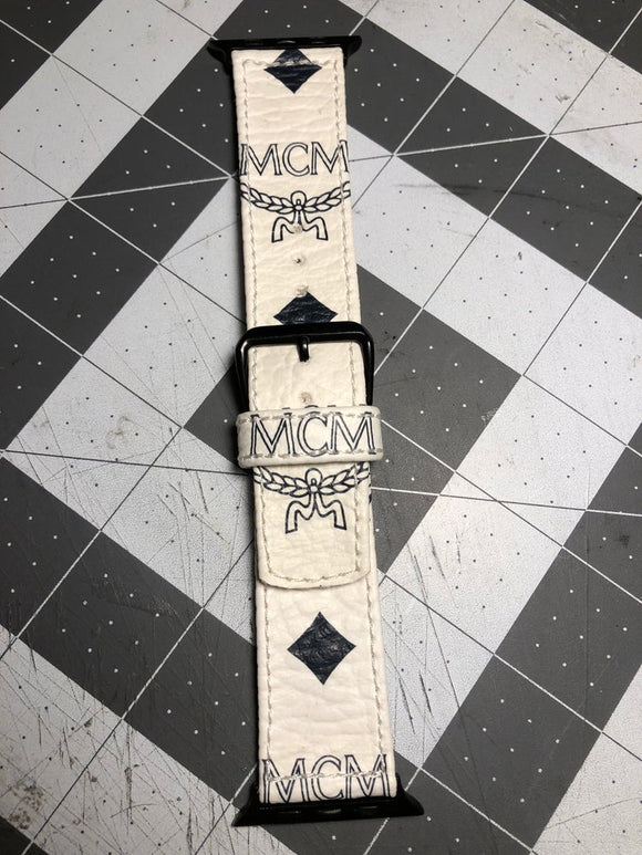 White MCM custom Apple Watch strap.