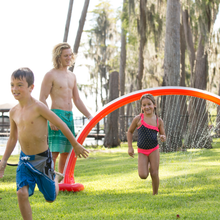 Load image into Gallery viewer, Giggle 'n Splash Rainbow Arch Sprinkler Front View Lifestyle