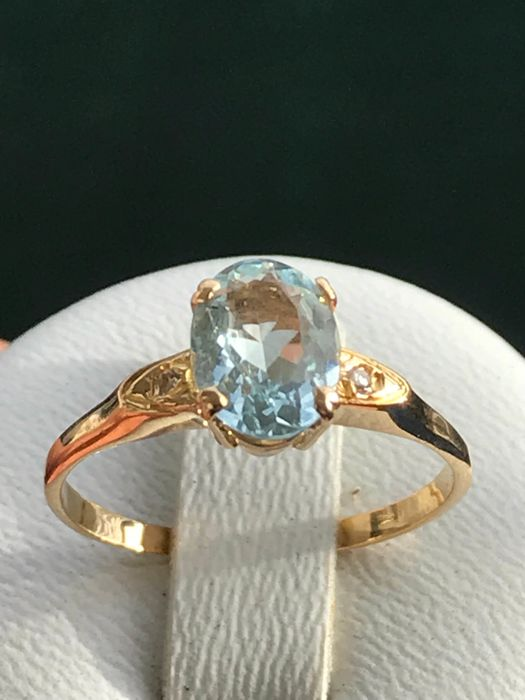bague or 18 carats aigue marine