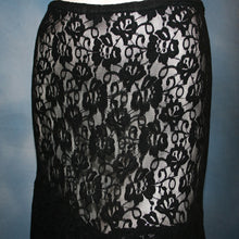 Load image into Gallery viewer, close view of Black lace Latin/rhythm skirt, 2 tier style, was created with yards of back stretch lace, with 2 full circles cut with sides higher, back longer on a hip base.