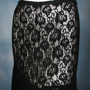 close view of Black lace Latin/rhythm skirt, 2 tier style, was created with yards of back stretch lace, with 2 full circles cut with sides higher, back longer on a hip base.