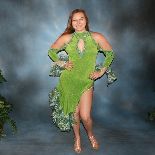 Crystal's Creations Green Latin/rhythm dance dress was created in apple green glitterknit slinky & printed chiffon flounces, embellished with sapphire & light sapphire Swarovski rhinestones, with hand beading.