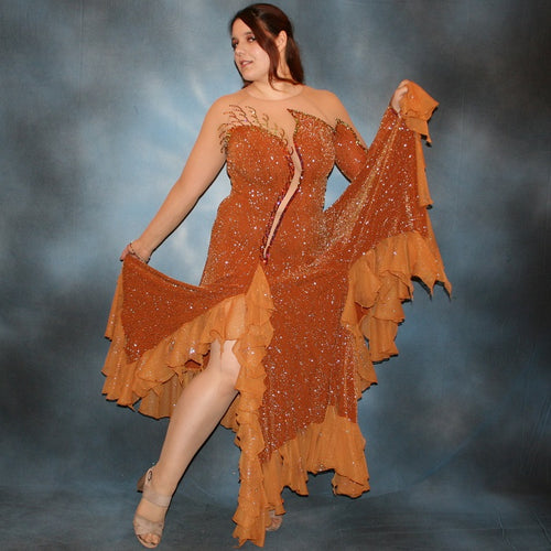 Crystal's Creations Bronze ballroom dress created in bronze glitter slinky with a swirl/ripple design on nude illusion base with oodles of amber glitter chiffon flounces, is embellished with volcano Swarovski rhinestone work.