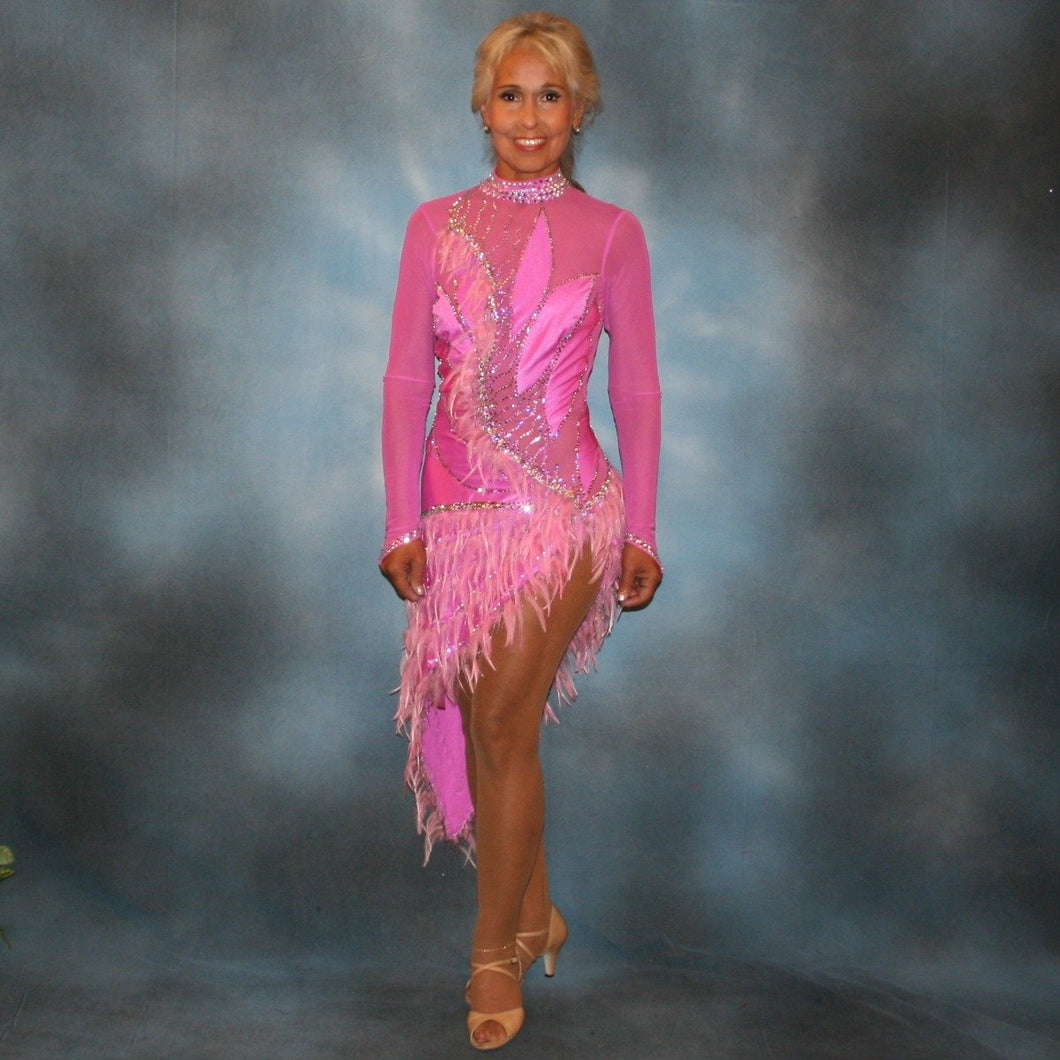 Crystal's Creations Orchid Latin/rhythm dress created in orchid lycra on an orchid sheer mesh base with detailed applique work, embellished with Swarovski rhinestone work in crystal vitrail light, along with orchid feather fringe.