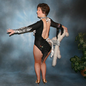 back view of Latin/rhythm dance dress created of black and white tiger print panne velvet on black sheer glissenette base, embellished with Aurora Swarovski rhinestones, hand beading, & a fluff of white marabou feathers.