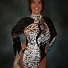 Load image into Gallery viewer, close upper view of Latin/rhythm dance dress created of black and white tiger print panne velvet on black sheer glissenette base, embellished with Aurora Swarovski rhinestones, hand beading, & a fluff of white marabou feathers.