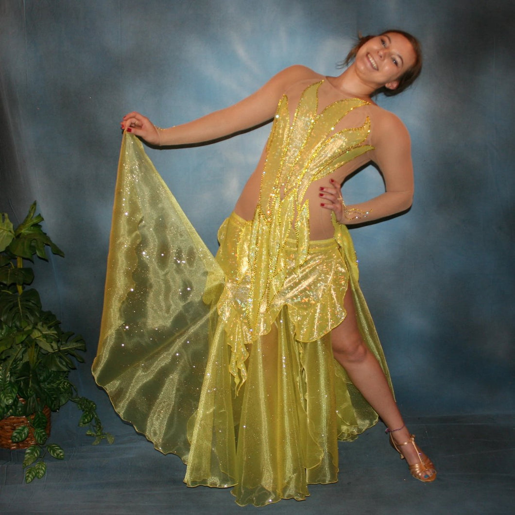 Crystal's Creations Yellow converta ballroom dress consisists of Latin/rhythm dress created of yellow hologram lycra overlayed artistically on nude  illusion base,  with handcut petal appliques on nude illusion base,embellished with citrine & jonquil ab Swarovski rhinestones, with converta skirt of yards of glittered organza.
