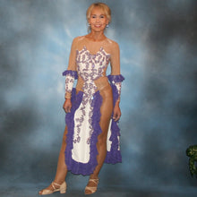 Load image into Gallery viewer, White Latin/rhythm dress created with purple lace motifs embellished with crystal Aurora borealis Swarovski rhinestones overlaid on white lycra, and on nude illusion. The finishing touch are ruffles of glitter flecked chiffon.
