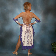Load image into Gallery viewer, back view of White Latin/rhythm dress created with purple lace motifs embellished with crystal Aurora borealis Swarovski rhinestones overlaid on white lycra, and on nude illusion. The finishing touch are ruffles of glitter flecked chiffon.