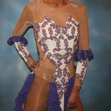 Load image into Gallery viewer, close upper view of White Latin/rhythm dress created with purple lace motifs embellished with crystal Aurora borealis Swarovski rhinestones overlaid on white lycra, and on nude illusion. The finishing touch are ruffles of glitter flecked chiffon.