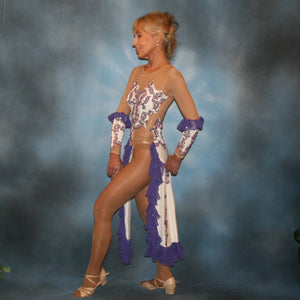 side view of White Latin/rhythm dress created with purple lace motifs embellished with crystal Aurora borealis Swarovski rhinestones overlaid on white lycra, and on nude illusion. The finishing touch are ruffles of glitter flecked chiffon.