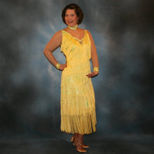 Load image into Gallery viewer, Crystal's Creations Yellow Latin/rhythm fringe dress created in yellow splash metallic lycra with yards of chainette fringe, sheer nude illusion sleeves, embellished with jonquil Swarovski rhinestones.
