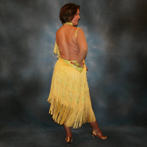 Crystal's Creations back view of Yellow Latin/rhythm fringe dress created in yellow splash metallic lycra with yards of chainette fringe, sheer nude illusion sleeves, embellished with jonquil Swarovski rhinestones.