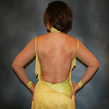 Load image into Gallery viewer, Crystal's Creations close back view of Yellow Latin/rhythm fringe dress created in yellow splash metallic lycra with yards of chainette fringe, sheer nude illusion sleeves, embellished with jonquil Swarovski rhinestones.
