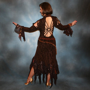 back view of Brown tango dress, bolero dress or rumba dress created in chocolate brown & bronze glitter slinky with chocolate brown metallic lace & metallic tricot flounces is embellished with crystal copper Swarovski rhinestones at neckpiece & hipsash, which also has extensive hand beading.
