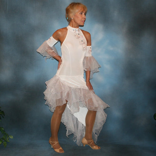Crystal's Creations White Latin/rhythm dress created in luxurious stretch velvet, features fancy organza flounces with delicate pink & blue bubble pearlized flocking, embellished with Swarovski rhinestone work, plus hand beading.