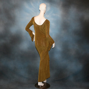 back view of Sage green Latin/rhythm/social dress created of luxurious sage green slinky features ruching up the right side & long sleeves with an open flared detail.