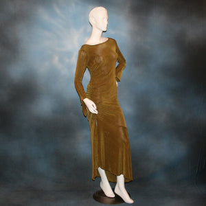 side view of Sage green Latin/rhythm/social dress created of luxurious sage green slinky features ruching up the right side & long sleeves with an open flared detail.